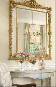 Mirror Over Dining Room Table - the dining room chandelier is reflected in the mirror above an