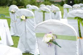 row decorated chairs on a outdoor wedding stock photo picture