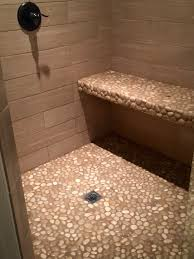 glazed tan pebble tile shower floor and bench pebble tile shop
