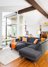 Orange And White Rugs Interesting View By Grey Sofas With Blue And Yellow Pillows Facing