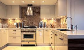 stylish kitchen furniture glowing metallic canisters in a modern kitchen decor