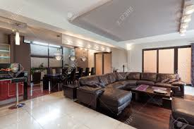 spacious living room spacious living room with huge sofa in a luxury house stock photo