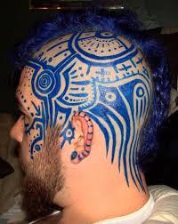 blue ink simple tribal design image on side of