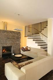 living room exposed brick wall fireplace mantel white mid