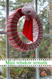 add cheer to your windows by decorating them for christmas