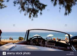 alfa romeo classic blue classic convertible open top white alfa romeo sports car parked