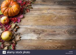 thanksgiving or fall greeting with pumpkins and fall leaves on