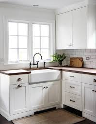 white kitchen cabinets with farm sink white shaker kitchen cabinets with wood countertops and