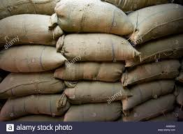 burlap sacks of grain in a merchant shop in town mattancherry