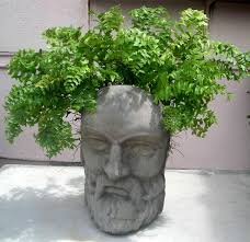 15 the most original stone head planters for your garden lovin