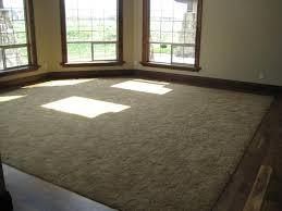 floorboards or carpet in with inlay wood floor bordering