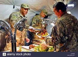 u s army capt jefferson left serves thanksgiving dinner