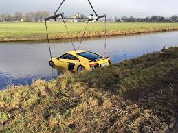 Audi R8 Yellow - german driver plunges audi r8 v10 plus into a river