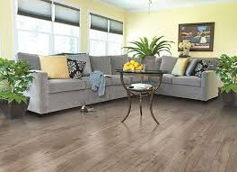 Best Wood Laminate Flooring Best Wood Laminate Flooring With Pale Yellow Wall Color And Grey