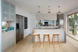 freedom furniture kitchens large windows white cabinets light flooring and caesarstone