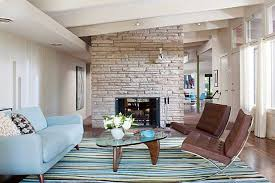 brown and blue living room with brown chairs and light blue sofa