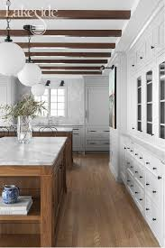 white kitchen cabinets with wood beams gorgeous white kitchen with stained wood accents gorgeous