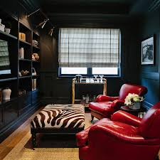 Waterleaf Interiors Black Paneled Den With Built In Shelves And Brass Picture Lights