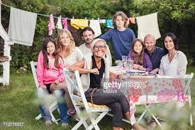 happy family and friends at garden lunch in back yard