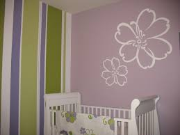 baby bedroom design with flower drawing on the wall irosi