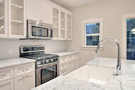 white dove kitchen cabinets with edgecomb gray walls crisp white kitchen with stairwell shelving american