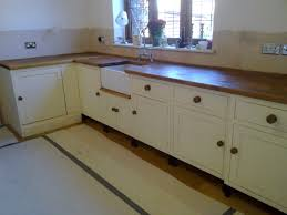 bespoke kitchen units made in reclaimed pine painted in farrow