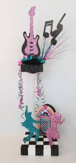 motownrock n roll musical ss s  more centerpieces  with jitterbug dancers s centerpiece from designsbyginnymyshopifycom