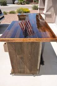 bar top made from pallet boards and covered with epoxy artistic