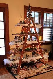 i think this is such a cute idea just an old ladder a few boards