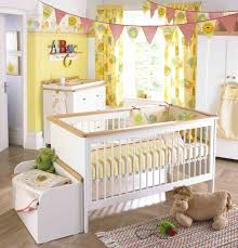 interior modern crib standing by cute carpet and dresser also