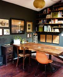 love the combination of the forest green walls parchment and