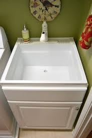 Laundry Room Sinks With Cabinet Less Pricey Sink Disguised Build A Cabinet Box Around Utility Sink