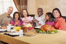 multigeneration american family gathering for meal