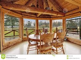 Log Floor by Beautiful Dining Room In Log Cabin House Royalty Free Stock Photo