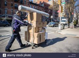 a fedex worker in chelsea in new york delivers packages on tuesday