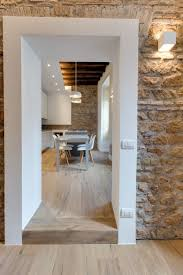 contemporary apartment with old wood structure and stone walls
