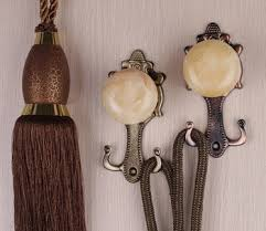 How To Use Curtain Tie Backs Hanging Curtain Tie Back Hooks Memsaheb Net