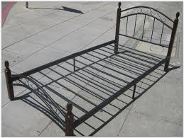 black twin metal bed frame bed and shower platform bed from a