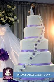 5 Tier Wedding Cake With Lavender Trimmings And Floral Accents