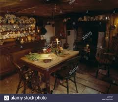 victorian cottage kitchen with small wooden table and dresser
