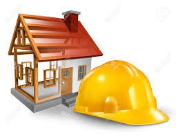house construction and home builder concept with a yellow worker