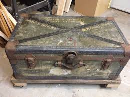 old military trunk and reclaimed 2x4s with metal caster wheels
