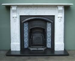 traditional fireplace with white marble mantel and wooden shelf