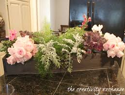 turn a garden box planter into a beautiful holiday table arrangement