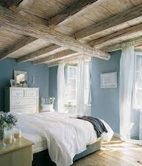 prachtige slaapkamer met blauw en hout accenten tref blauw hout