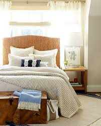10 ways to place your bed in front of a window how to decorate mix and roman shade with sheer drapery behind the bed
