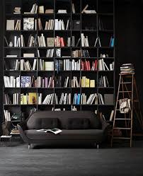 cool home office with using small library along wall dark
