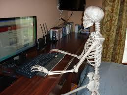 spirit halloween tuscaloosa reading the news is scary skeleton on the sofa pinterest