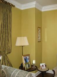 living room painted with green gold striae glaze finishgold color