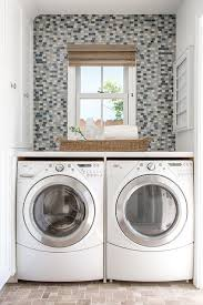 white and blue laundry room with blue trellis roman shades